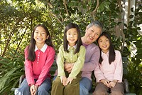 Asian grandmother with granddaughters outdoors