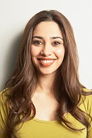 Close up of young Hispanic woman smiling