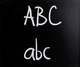 ABC handwritten with white chalk on a blackboard