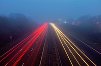 UK, England, Motorway in fog at dusk