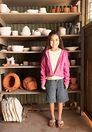 Hispanic girl in pottery shed