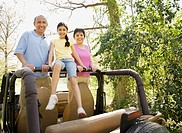 Grandparents and granddaughter in jeep