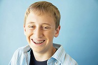 Teenaged boy smiling with braces