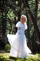gorgeous bride in forest in summer season