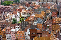 vivid medieval house roofs covered with traditional red and orange tiles in Strasbourg city