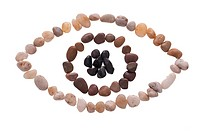 An eye made out of beach pebbles isolated on the white