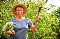 Portrait of happy mature woman in the garden.