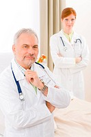 Medical team _ portrait of two doctor with stethoscope in hospital