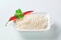 Boiled white rice in a porcelain dish