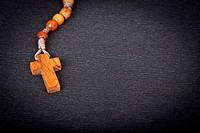 Christian Wooden Rosary on black background