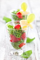 mixed salad with strawberries and cheese