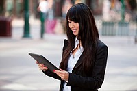 Smiling business woman using tablet pc