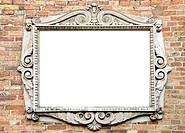 old wall with original vintage and epmty frame for text