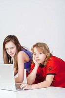 young boy and girl having fun with laptop computer