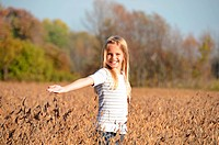 Young girl in a soybean field.