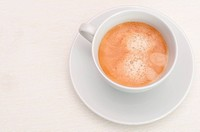Espresso Coffee in White Cup on Light Tablecloth