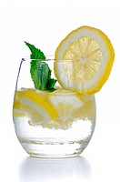 Glass of fresh cool tonic with lime fruits isolated on white background