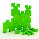 Green brocken puzzle over white background. 3d rendered image