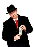 man in an overcoat and hat, with the dollar in the hands of