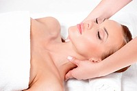 Young pretty woman getting neck massage