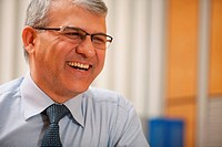 Senior businessman smiling