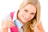 Home shopping _ young woman holding credit card on white background