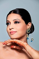Beautiful woman with mehndi and jewelry