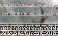 Carved patterns in the old white marble