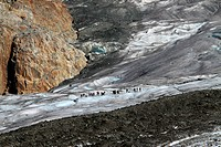 Large group of hikers in the distance, Aletsch Glacier, Valais Canton, Switzerland