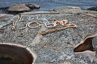 A rope spelling LOVE on a rocky coastline