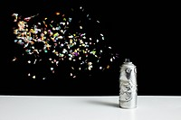 Floating confetti and a damaged spray paint can (thumbnail)