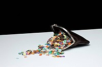 Confetti spilling out of a coin purse