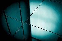 Close_up spot lit reflection in blue toned mirrors