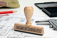A MADE IN GERMANY rubber stamp on a blueprint