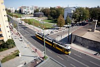 A street scene with a tram, tilt_shift, Berlin, Germany
