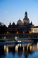 A tour boat on the Elbe River waterfront of Dresden, Germany