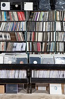 Rows of records on shelves and in bins at a record store