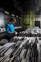 A young man searching through records in a record store (thumbnail)