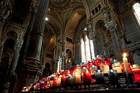 Lit votive candles in the Basilica Notre Dame De Fourviere, Lyon France (thumbnail)