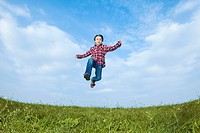 A boy jumping in the air