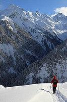 Person hiking on snowy mountain (thumbnail)