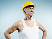 A senior man wearing a hardhat and tank top