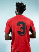A man wearing a numbered soccer shirt (thumbnail)