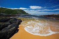 Surf on beach in small cove near Storms River mouth, Tsitsikamma National Park, Garden Route, South Africa
