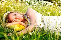 Portrait of pregnant woman on the camomile field