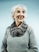 An elegant senior woman smiling and looking away