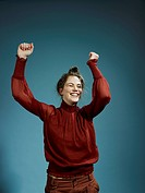 A young hip woman with her arms raised in celebration (thumbnail)