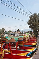A row of moored Trajineras, a traditional gondola type Mexican tour boat