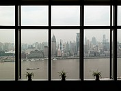Shanghai skyline seen through window