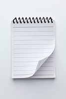 A spiral notepad with lined paper and a curled up page corner
